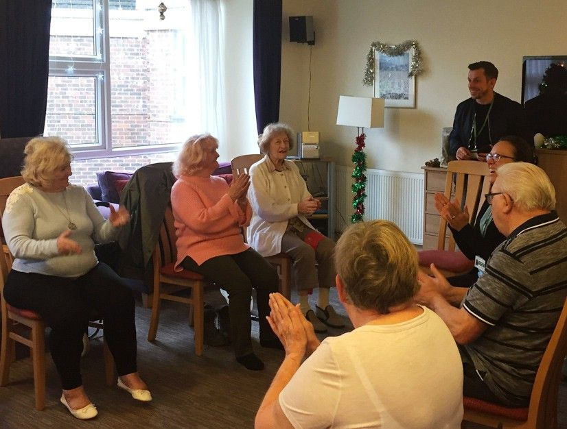 Residents taking a keep fit class in the lounge